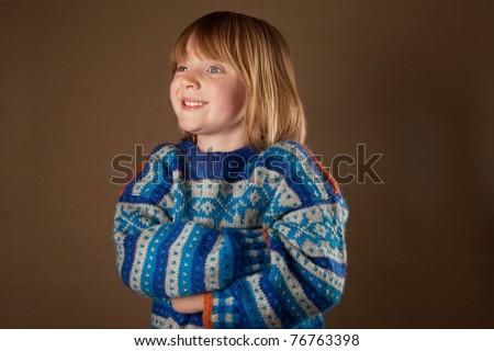 Child In Sweater Knit Wear Cute Blonde Boy With Long