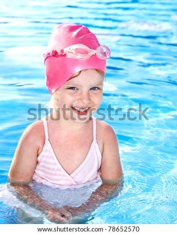 Child in swimming pool. - stock photo