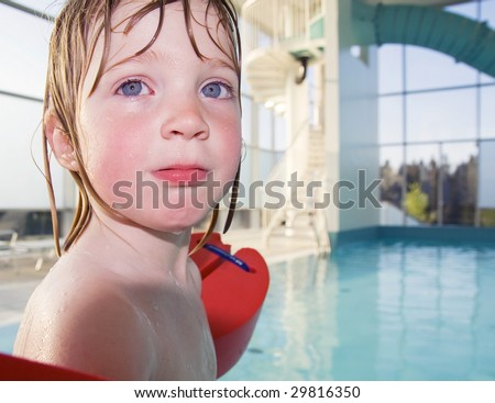 stock photo child in swimming pool with wings toddler in water in leisure center 29816350 Toddler Swimming Pools