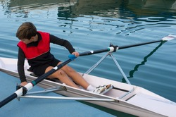 Child in the course of rowing on single