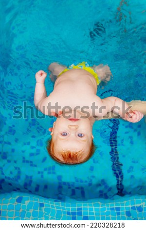 child in the pool. swimming for infants, disease prevention
