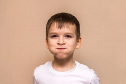 child indulges in front of the camera. portrait of a boy of six years old close-up.