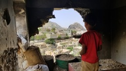 Child inspects their destroyed house due to the war in Yemen...