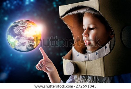 child is dressed in an astronaut costume #272691845