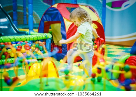 child is playing in the children's room. Children in the entertainment center. Fun in the children's playroom