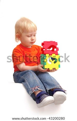 Child keeps house from puzzles