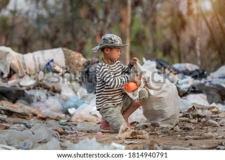 Child labor. Children are forced to work on rubbish. Poor children collect garbage. Poverty,  Violence children and trafficking concept,Anti-child labor, Rights Day on December 10.