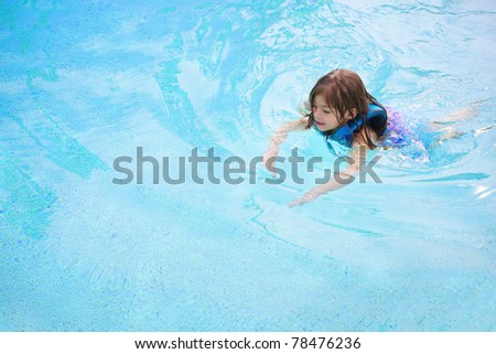 Child learning to swim (Lots of Copy Space)