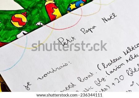 Child letter to Santa Claus written in French (Petit Papa Noel = Dear Santa)