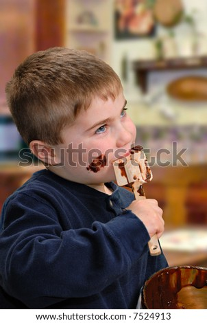 Child licking chocolate batter off spatula