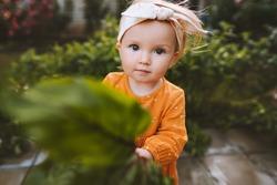 Child little girl holding freshly picked beet cute baby in garden healthy lifestyle vegan food organic summer season