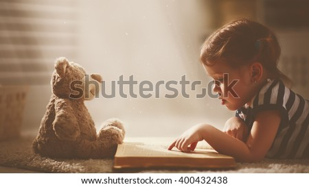 child little girl reading a...