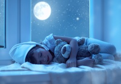 child little girl  sleeping at the window dreaming  the starry sky at bedtime night