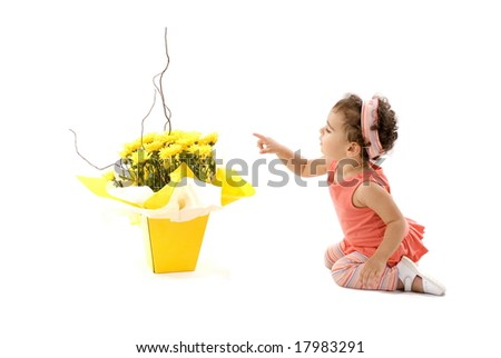 Child looking and point at gift flower pot .