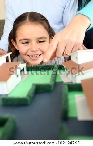 Child looking at a model of a housing estate