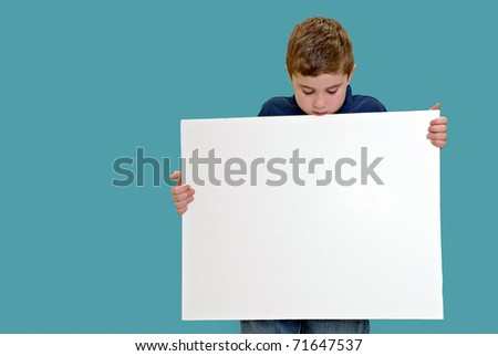 Child looking down at blank white board for your copy