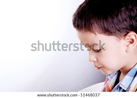 Child looking down with space to insert text or design