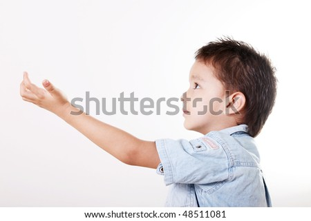 Child looking up with hand extended