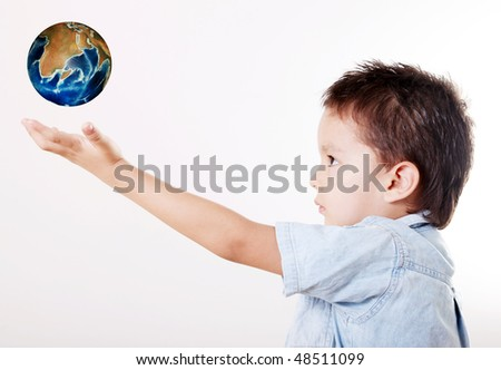 Child looking up with hand extended and taking the world