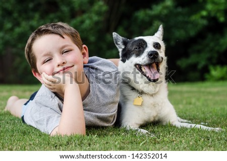 stock-photo-child-lovingly-embraces-his-pet-dog-a-blue-heeler-142352014.jpg