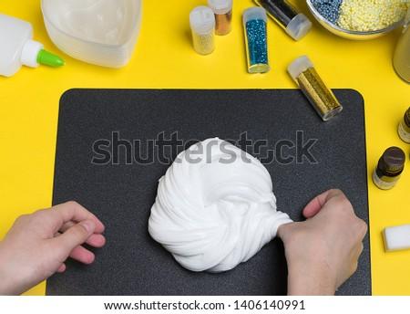 Child making a white, fluffy slime
