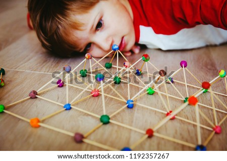 child making geometric shapes, engineering and STEM #1192357267