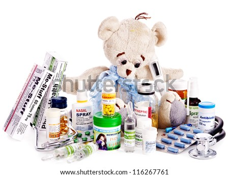 Child medicine and teddy bear. Isolated.