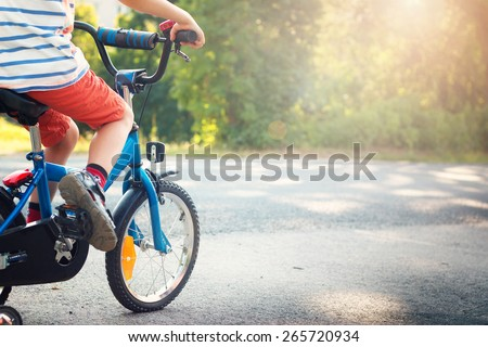 Shutterstock child on a bicycle at asphalt road