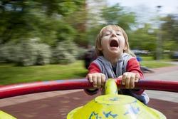 Child on merry-go-round