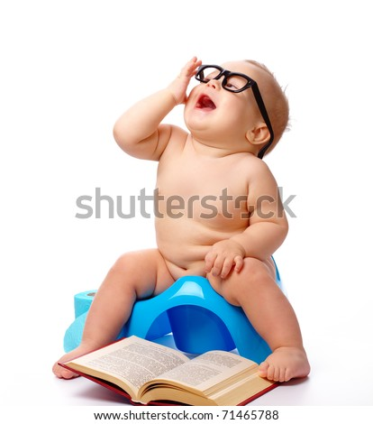 Child on potty play with glasses and book, isolated over white - stock photo
