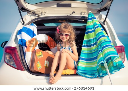 Child on vacation. Summer holiday and car travel concept