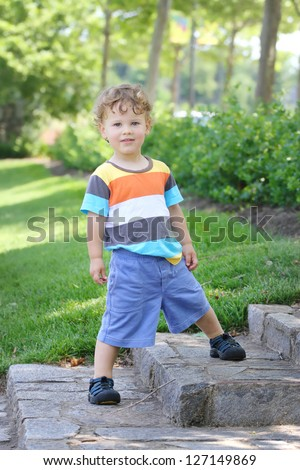 Child outdoors in a park in summer, active and fit