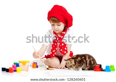 child painting and playing with cat kitten
