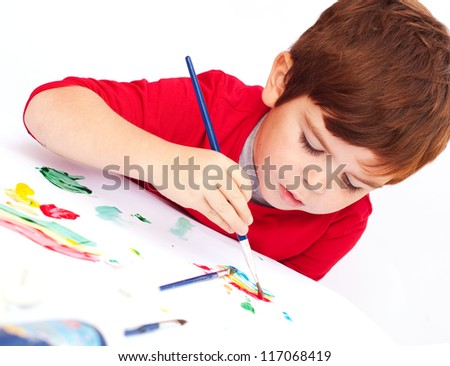 Child painting with a brush