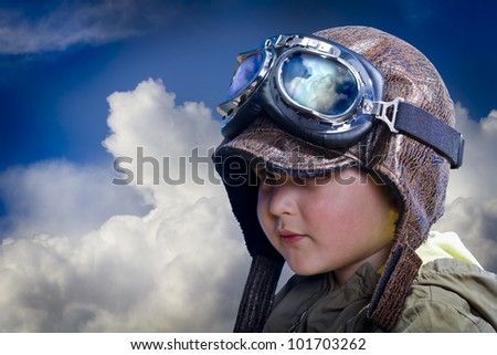Child pilot, cute and funny over background clouds