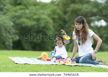 child play toy with mum in park