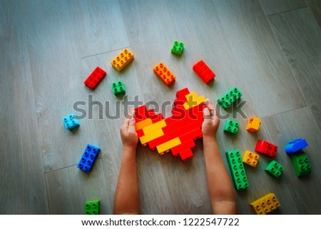 child play with colorful plastic blocks, learning activities for kids #1222547722
