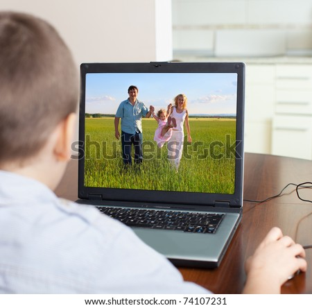 Child playing a computer at home