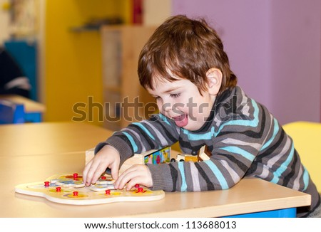 Child playing at kindergarten