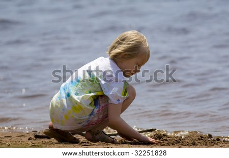 Child playing at the beach on Barkers Island, Wisconsin in Lake Superior