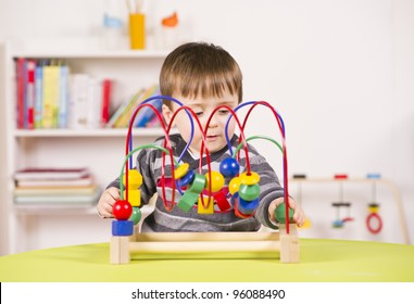 A stock photo of a child playing with a challenging toy in the play room