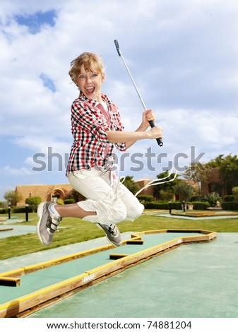 Child playing golf.