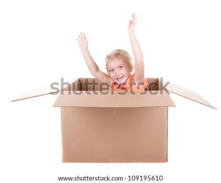 Child playing in a cardboard box, isolated on white