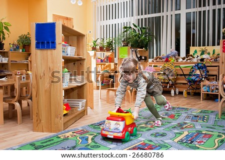 Child playing in kindergarten