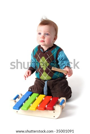 Child Playing Music On Wood Xylophone Instrument. Toddler Boy With