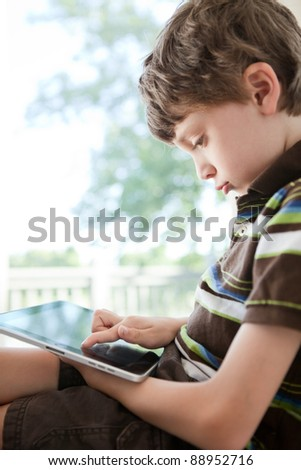 Child playing on a tablet PC