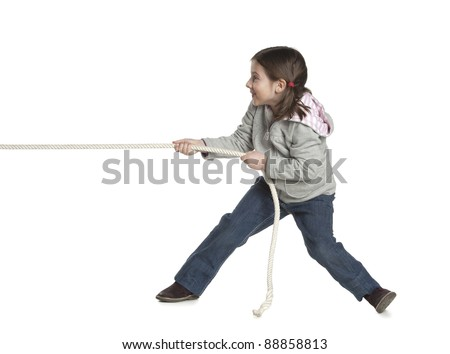 child playing tug of war