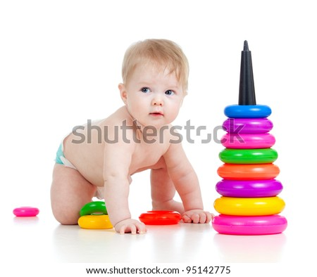 child playing with color developmental toy
