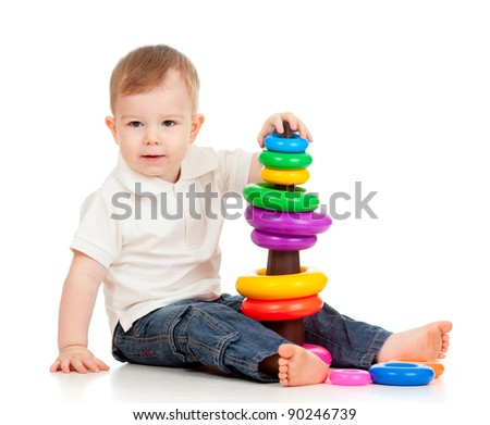 child playing with color pyramidion