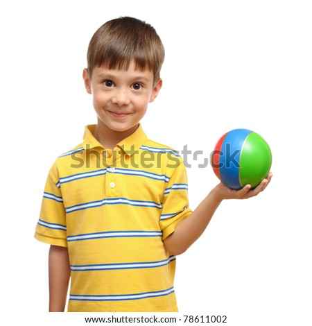 Child playing with colorful toy rubber ball isolated on white background - stock photo